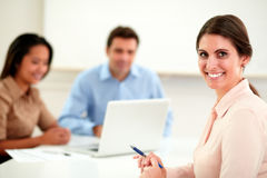 Beautiful businesswoman looking and smiling at you Royalty Free Stock Photo
