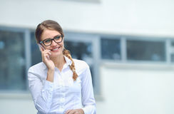 Beautiful businesswoman make call by mobile cell phone Stock Photo