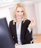 Beautiful businesswoman making a hand gesture Stock Images