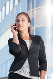 Beautiful businesswoman with mobile phone. Beautiful businesswoman talking with mobile phone Royalty Free Stock Photo