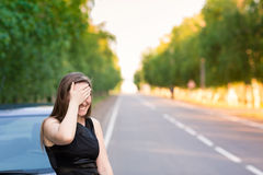 Beautiful businesswoman near her car with facepalm Royalty Free Stock Photography