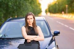Beautiful businesswoman near her car Stock Photo