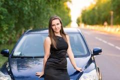 Beautiful businesswoman near her car Stock Image