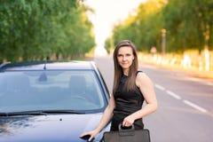 Beautiful businesswoman near her car Stock Photography