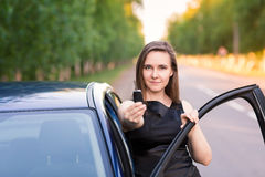 Beautiful businesswoman near her car Stock Images