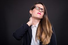 Beautiful businesswoman with neck pain royalty free stock photos