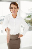 Beautiful businesswoman offering handshake in office Royalty Free Stock Photo