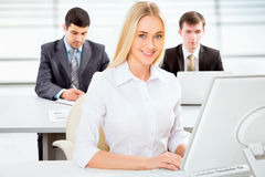 Beautiful businesswoman in an office Royalty Free Stock Photos