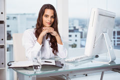 Beautiful businesswoman at office desk Stock Images