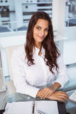 Beautiful businesswoman at office desk Royalty Free Stock Photos