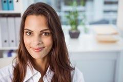 Beautiful businesswoman in office Stock Photos