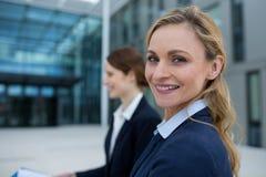 Beautiful businesswoman in office premises. Portrait of beautiful businesswoman in office premises Stock Image