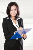 Beautiful businesswoman in office Stock Photo