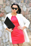 Beautiful businesswoman outdoors. Beautiful businesswoman posing and smiling outdoors stock photography