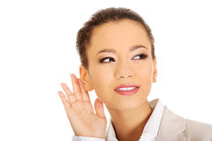 Beautiful businesswoman overhears. Royalty Free Stock Photography