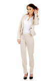 Beautiful businesswoman overhears. Stock Images