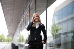 Beautiful businesswoman on the phone. Outdoor the office Royalty Free Stock Images
