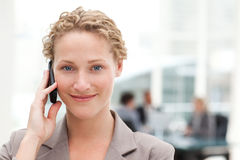 Beautiful businesswoman phoning in her office Royalty Free Stock Image