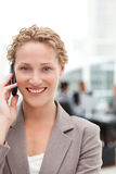 Beautiful businesswoman phoning in her office Stock Image