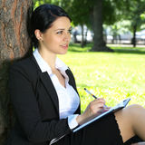 Beautiful businesswoman planning Royalty Free Stock Photo
