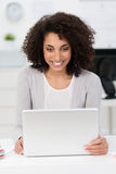 Beautiful businesswoman with a pleased smile Royalty Free Stock Photos
