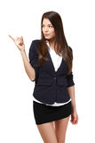 Beautiful businesswoman pointing at copyspace Stock Photo