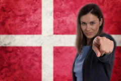 Beautiful businesswoman pointing her finger at you Danish flag b Stock Photography