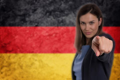 Beautiful businesswoman pointing her finger at you German flag b Stock Image