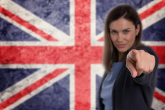 Beautiful businesswoman pointing her finger at you German flag b Royalty Free Stock Photos
