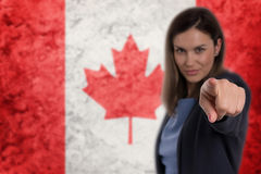 Beautiful businesswoman pointing her finger at you German flag b Stock Photo