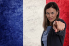 Beautiful businesswoman pointing her finger at you German flag b Royalty Free Stock Image