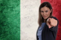 Beautiful businesswoman pointing her finger at you Italian flag Royalty Free Stock Photos