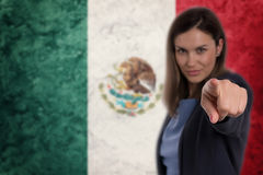 Beautiful businesswoman pointing her finger at you Mexican flag. Background. Businesswoman pointing her finger at you royalty free stock photography