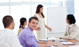 Beautiful businesswoman presenting figures Royalty Free Stock Image