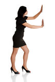 Beautiful businesswoman push imaginary wall Royalty Free Stock Photos