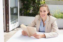 Beautiful businesswoman reading a book Royalty Free Stock Photography