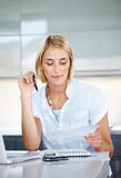 Beautiful businesswoman reading a contract paper Royalty Free Stock Photography