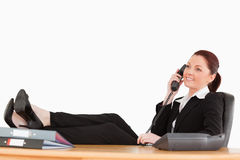 Beautiful businesswoman relaxing in her office Royalty Free Stock Photography