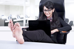 Beautiful businesswoman relaxing in office Stock Photo