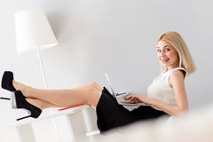 Beautiful businesswoman is relaxing during work Royalty Free Stock Images