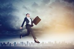 Beautiful businesswoman running on the road Royalty Free Stock Image