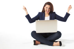 Stressed young businesswoman with laptop Stock Photography