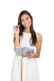 Beautiful businesswoman or secretary holding a pen and a clipboard Stock Photos