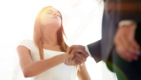 Beautiful businesswoman shaking hand with her partner. Businesswoman making handshake with a businessman - greeting, dealing, merger and acquisition concepts Royalty Free Stock Photos