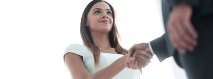 Beautiful businesswoman shaking hand with her partner. Businesswoman making handshake with a businessman - greeting, dealing, merger and acquisition concepts Stock Image