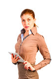 Beautiful businesswoman in shirt with the device Royalty Free Stock Photography