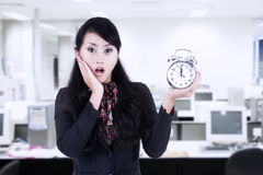 Beautiful businesswoman shock at deadline clock Stock Photo