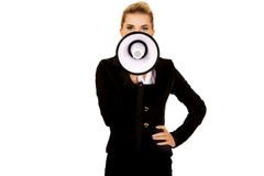 Beautiful businesswoman shouting with megaphone Royalty Free Stock Photography