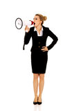 Beautiful businesswoman shouting with megaphone Royalty Free Stock Photos