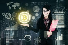 Beautiful businesswoman showing bitcoin Royalty Free Stock Photo